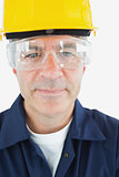 Confident technician wearing protetive glasses and hardhat