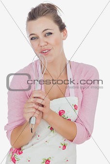 Maid using whisk as microphone