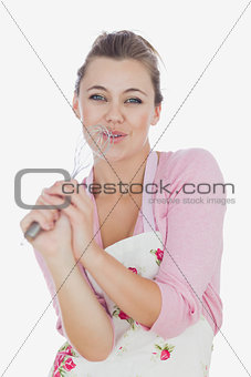 Maid using wire whisk as microphone while signing