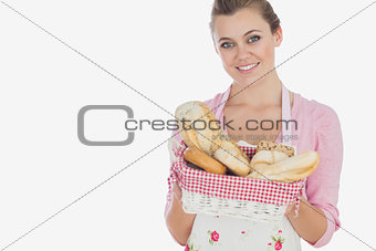 Beautiful woman holding bread basket