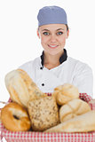 Female chef with variety of breads