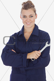 Beautiful female mechanic holding wrench