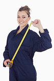 Female mechanic with measuring tape