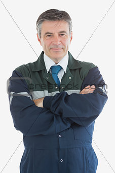 Portrait of confident repairman with arms crossed