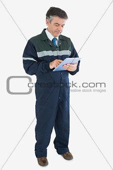 Mature repairman using digital tablet
