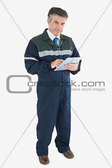Portrait of repairman holding digital tablet