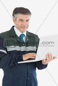 Portrait of repairman using laptop