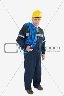 Portrait of mature repairman with large wire and hardhat