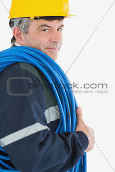 Mature repairman with rolled wire