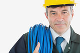 Repairman with rolled wire wearing hardhat