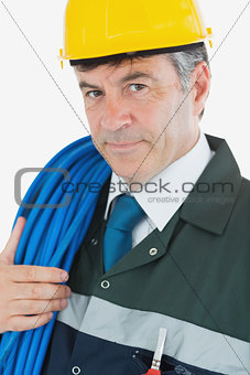 Portrait of repairman with large wire and hardhat