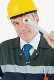 Mature repairman holding wrench