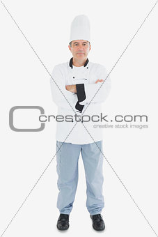 Portrait of mature chef with arms crossed