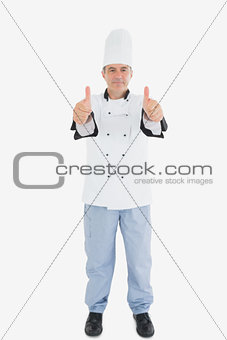 Portrait of mature male chef gesturing thumbs