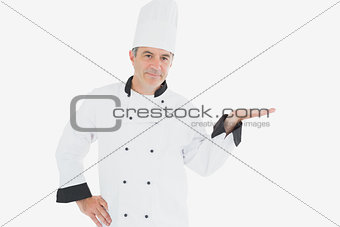Mature chef displaying invisible product