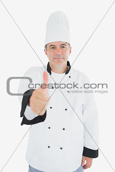 Mature chef showing thumbs up sign
