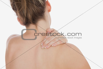 Topless woman massaging back