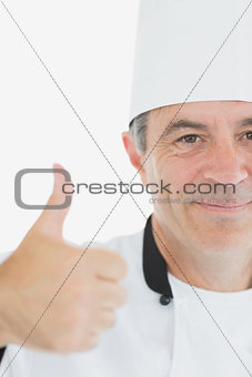 Cropped image of chef gesturing thumbs up