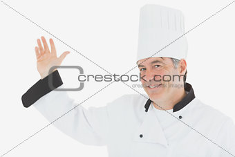 Portrait of mature chef gesturing