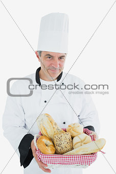 Man in chef uniform with bread basket