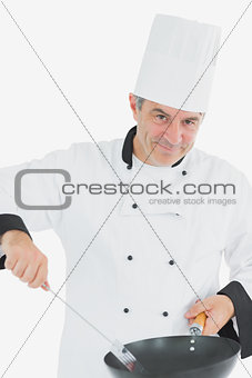 Portrait of male chef cooking food