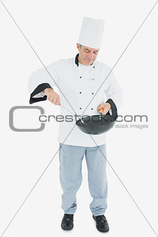 Man in chef uniform cooking food