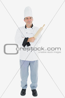Portrait of male chef holding rolling pin