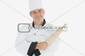Mature chef holding rolling pin