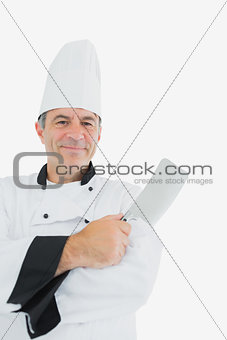 Portrait of chef with meat cleaver
