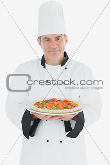 Portrait of chef with pizza