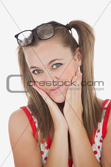 Beautiful young woman with hands on face