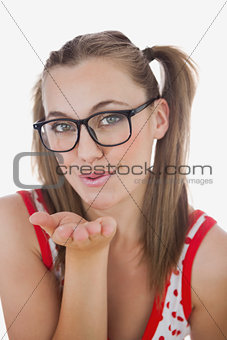 Portrait of young woman blowing air kiss