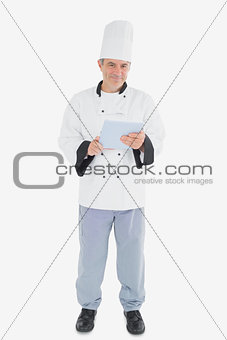 Portrait of male chef holding digital tablet