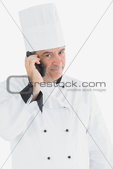 Portrait of male chef on call