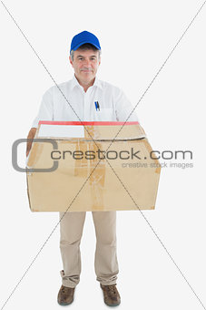 Mature courier man carrying package