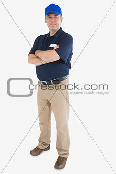 Mature courier man with arms crossed