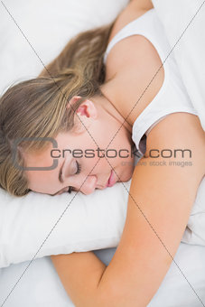 Overhead view of serene woman sleeping