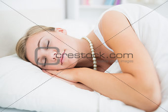 Sleeping woman with pearls necklace
