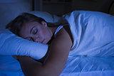 Blonde woman sleeping at night