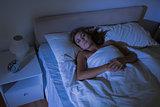 Calm woman sleeping at night
