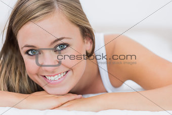 Blond woman lying on her bed