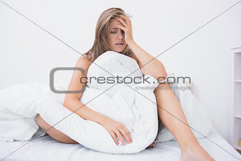 Blonde woman has just waking up