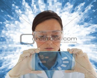 Thoughtful nurse holding a virtual screen