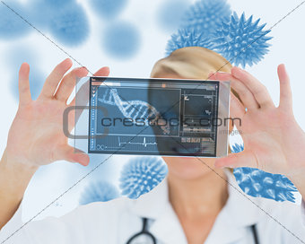 Blonde nurse holding a virtual screen