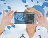 Cheerful blonde nurse holding a virtual screen