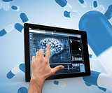 Hand touching brain on a digital tablet