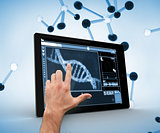 Hand touching a dna on a digital tablet
