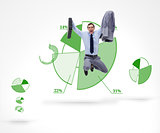 Man in suit jumping against a graphical pie