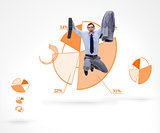 Man jumping against a graphical pie in background
