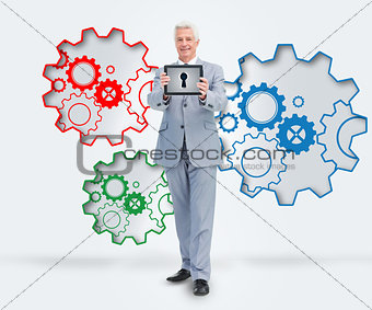 Smiling businessman standing against a background